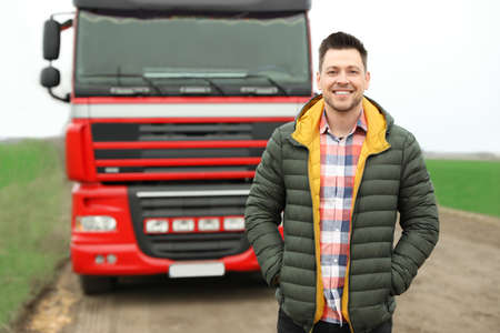 Portrait of driver at modern truck outdoors Stock Photo