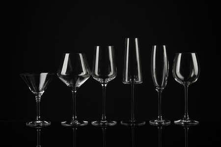 Set of empty glasses on black background