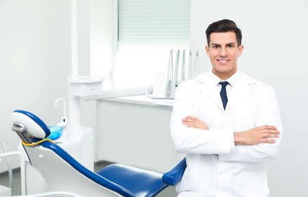 Portrait of professional male dentist in clinic. Space for text