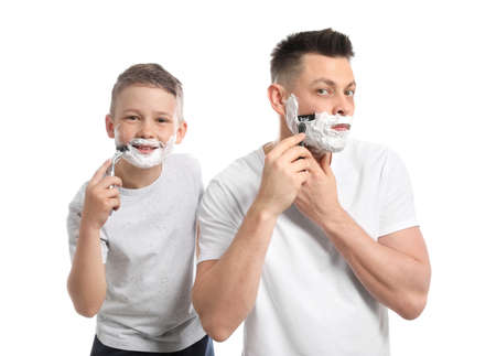 Dad shaving and son imitating him on white background