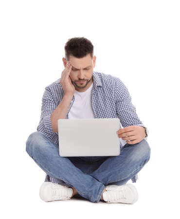 Emotional man with laptop on white background