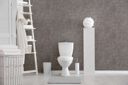 Ceramic toilet bowl in stylish bathroom. Idea for interior design