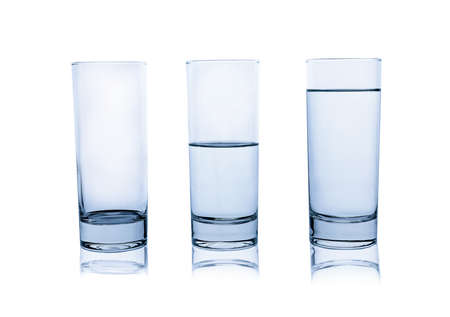 Empty, half and full glasses of water on white background