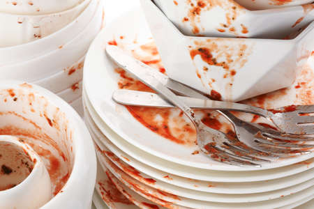 Pile of dirty dishes and cutlery, closeup Stock Photo