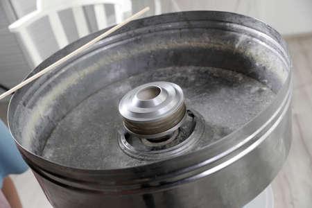Making tasty cotton candy using modern machine, closeup Reklamní fotografie