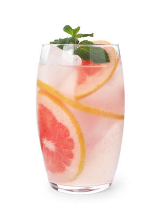 Glass of grapefruit refreshing drink with ice cubes and mint on white background