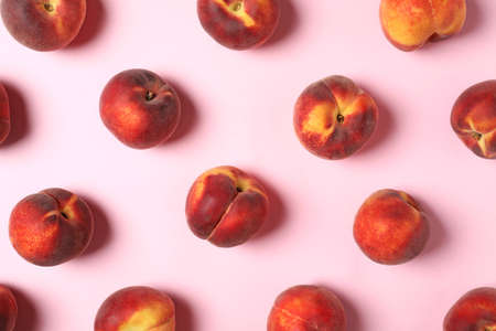 Flat lay composition with sweet juicy peaches on pink background Фото со стока