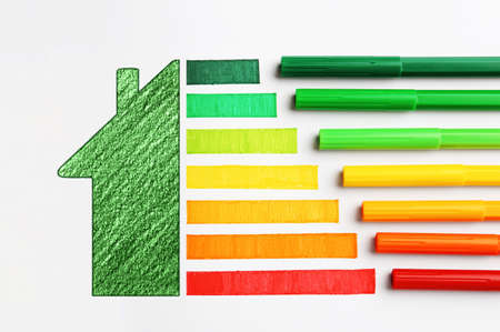 Colorful  markers and drawing on white background, top view. Energy efficiency concept Archivio Fotografico