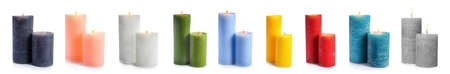 Set with different decorative wax candles on white background. Banner design Foto de archivo