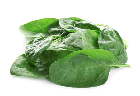 Heap of fresh green healthy baby spinach leaves isolated on white