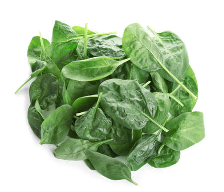 Heap of fresh green healthy baby spinach leaves isolated on white, top view