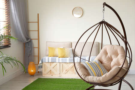 Stylish modern room interior with swing chair Stockfoto