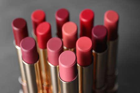 Set of bright lipsticks on grey background