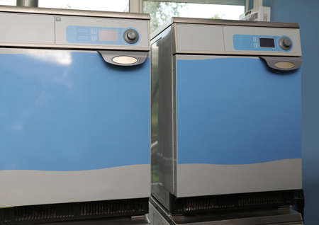 Pair of industrial machines in modern dry-cleaning