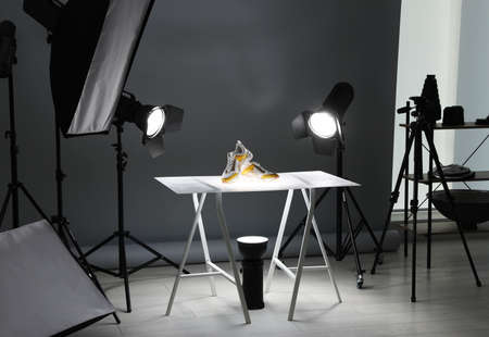Professional photography equipment prepared for shooting stylish shoes in studio 免版税图像