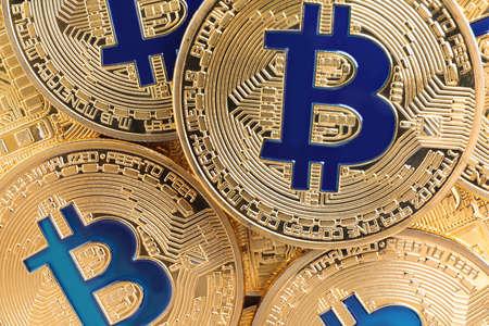 Shiny gold bitcoins as background, closeup view. Digital currency 版權商用圖片