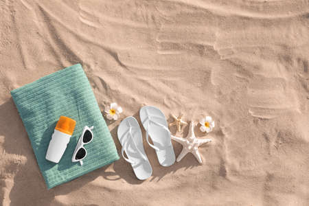 Flat lay composition with beach accessories on sand. Space for text Stock Photo