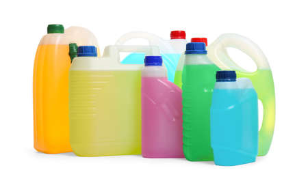 Plastic canisters with different liquids for car on white background
