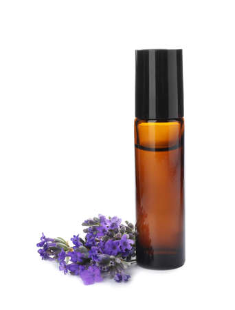 Bottle with natural lavender oil and flowers on white background