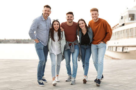 Group of happy people spending time together at promenade Stock Photo