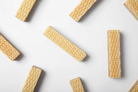 Flat lay composition with delicious crispy wafers on white background
