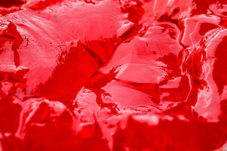 Delicious red fruit jelly as background, closeup