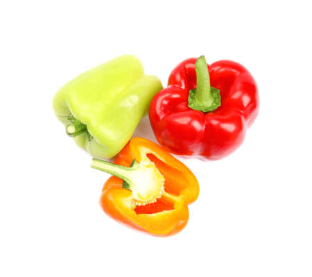 Whole and cut bell peppers on white background, top view Banque d'images
