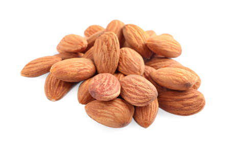 Organic dried apricot kernels on white background