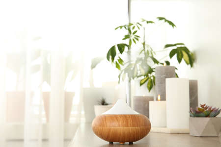 Composition with modern essential oil diffuser on wooden shelf indoors, space for text Stock Photo