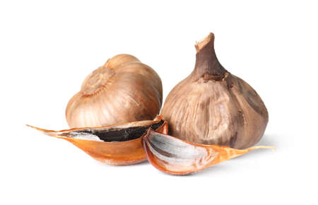 Aged black garlic on white background. Asian cuisine