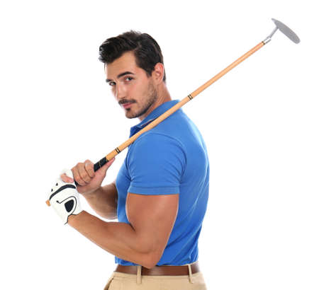 Young man posing with golf club on white background