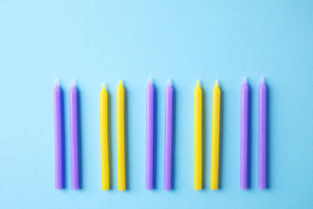 Colorful birthday candles on light blue background, flat lay 版權商用圖片