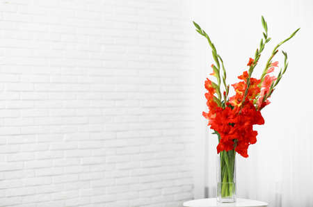 Vase with beautiful gladiolus flowers on wooden table indoors. Space for text Stock fotó - 127759054