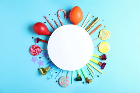 Different birthday party items and blank card on light blue background, flat lay. Space for text