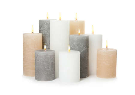 Many alight wax candles on white background Stok Fotoğraf