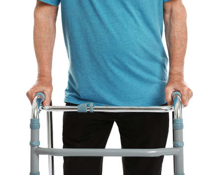 Elderly man using walking frame isolated on white, closeup