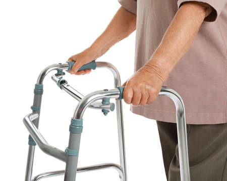 Elderly woman using walking frame isolated on white, closeup