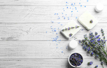 Flat lay composition of handmade soap bars with lavender flowers on white wooden background. Space for text Stock fotó
