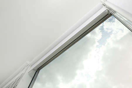 Modern window with white roller blinds indoors, low angle view Stockfoto