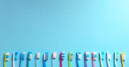 Flat lay composition with toothbrushes on color background. Space for text
