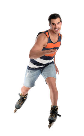 Handsome young man with inline roller skates on white background 免版税图像