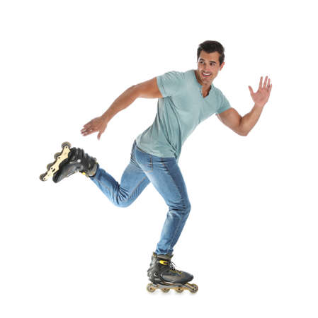 Handsome young man with inline roller skates on white background Archivio Fotografico