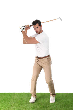 Young man playing golf on white background 写真素材