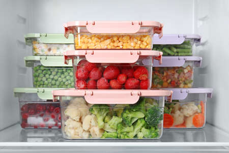Boxes with different products inside of refrigerator