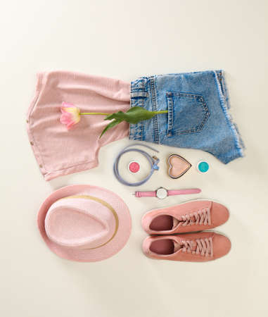 Flat lay composition with stylish summer clothes and accessories on light background Stock Photo