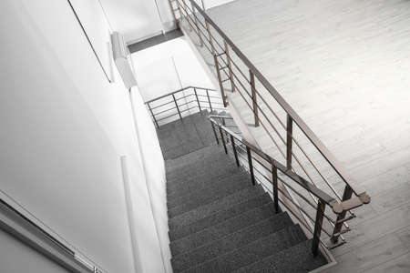 Stone stairs with metal railing indoors, view through CCTV camera Banque d'images
