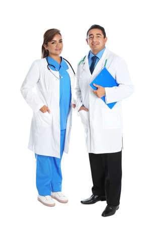 Full length portrait of Hispanic doctors isolated on white. Medical staff 免版税图像
