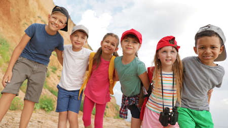 Cute little children outdoors on summer day. Camping trip Stock Photo