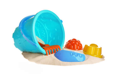Set of plastic beach toys and pile of sand on white background Banco de Imagens
