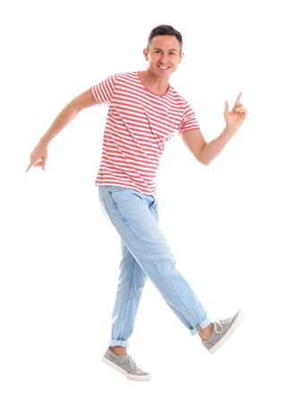 Happy attractive man dancing on white background